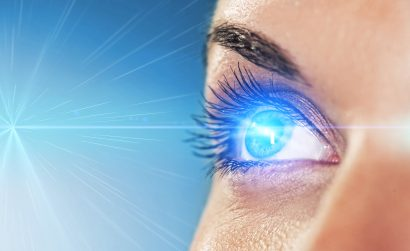 concept image of a female's right eye absorbing light entering it