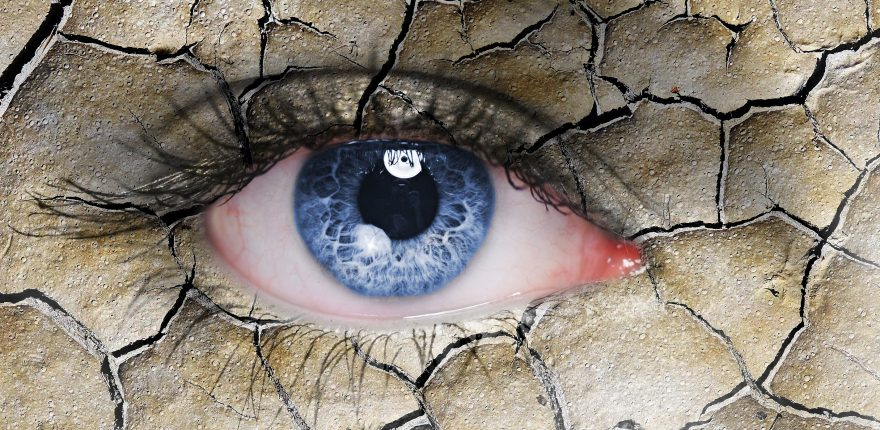 concept illustration of a dry, red eye made to look like a dry, cracked desert landscape