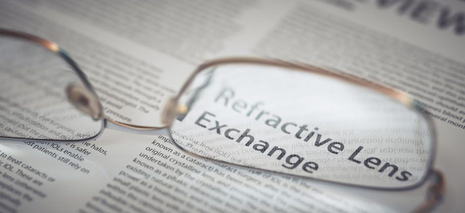 reading glasses resting on an open newspaper magnifying refractive lens exchange