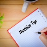 a person documenting nutrition tips in a notepad